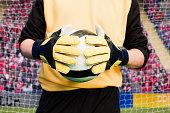 Goalkeeper holding football