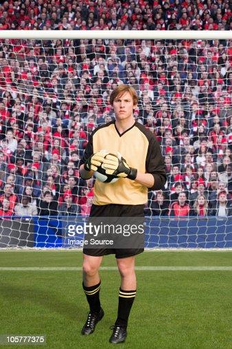 Goalkeeper holding football : Stock Photo