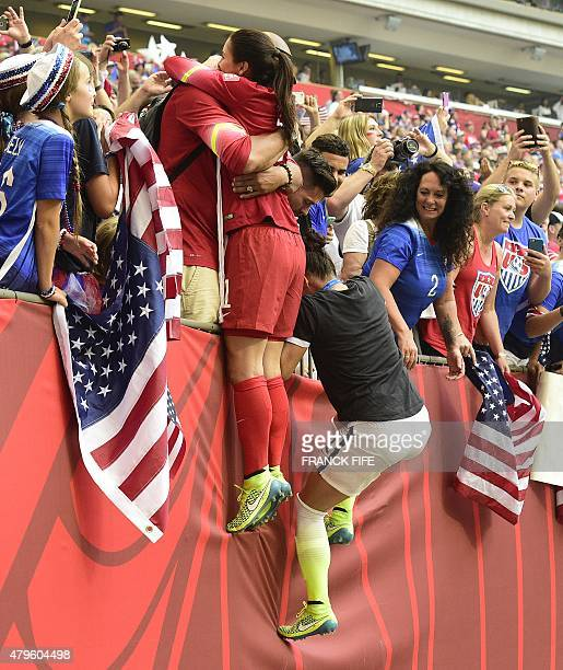 USA goalkeeper Hope Solo is hugged by husband Jerramy Stevens after winning the final football match between USA and Japan during their 2015 FIFA...