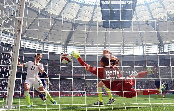 Goalkeeper Hope Solo of the United States of America fails to save this own goal by Julie Johnston against Japan in the FIFA Women's World Cup Canada...