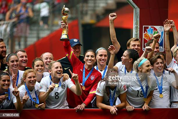 Goalkeeper Hope Solo of the United States of America holds the World Cup Trophy after their 52 win over Japan in the FIFA Women's World Cup Canada...