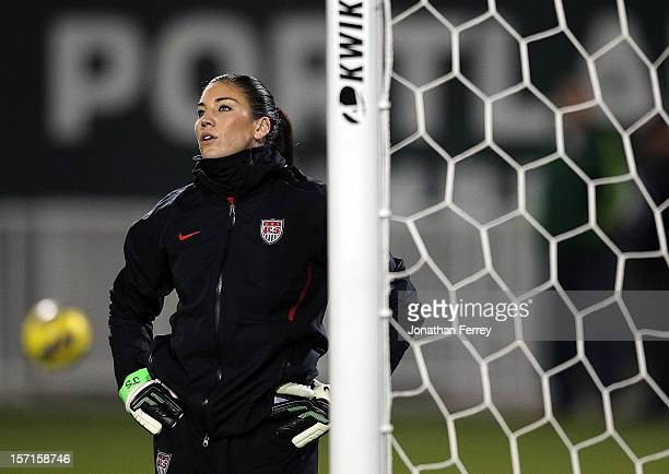 Goalkeeper Hope Solo of the United States wears wrist bands with the initials 'JS' for her husband Jeremy Stevens during the game against Ireland on...