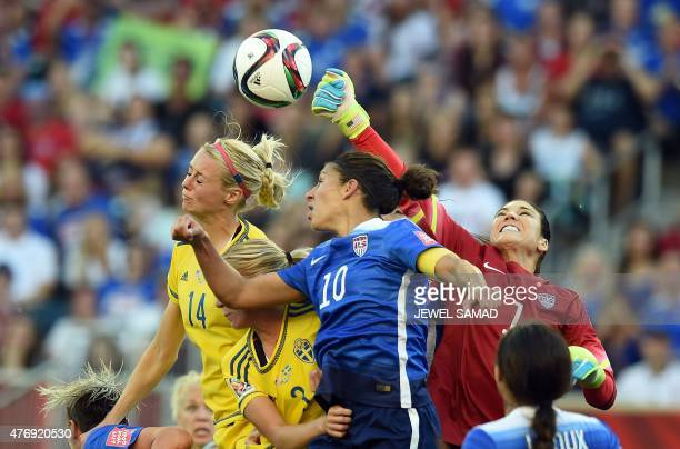 USA goalkeeper Hope Solo punches the ball away as Sweden's defender Amanda Ilestedt goes for a header during their Group D match of the 2015 FIFA...
