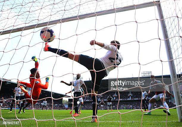 Goalkeeper Hugo Lloris of Spurs and Gylfi Sigurdsson of Spurs fail to stop the ball going into the net as teamateHarry Kane of Spurs scores an own...