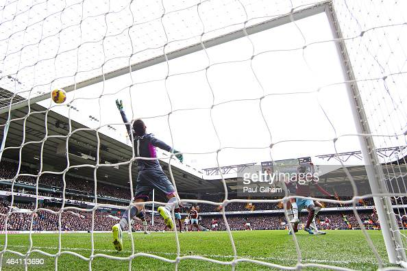 Goalkeeper Hugo Lloris of Spurs dives in vain as Cheikhou Kouyate of West Ham rises above Jan Vertonghen of Spurs to score the opening goal with a...