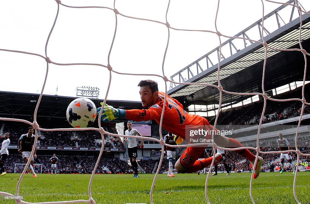 Goalkeeper Hugo Lloris of Spurs dives in vain as <a gi-track='captionPersonalityLinkClicked' href=/galleries/search?phrase=Stewart+Downing&family=editorial&specificpeople=238961 ng-click='$event.stopPropagation()'>Stewart Downing</a> (not shown) of West Ham scores his team's second goal during the Barclays Premier League match between West Ham United and Tottenham Hotspur at Boleyn Ground on May 3, 2014 in London, England.