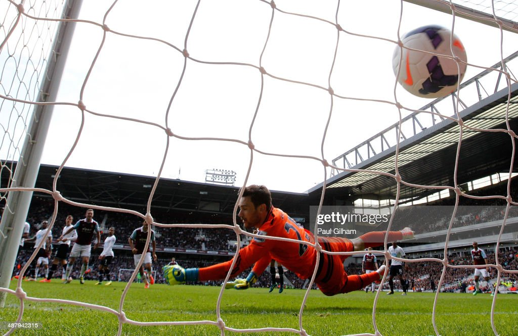 Goalkeeper Hugo Lloris of Spurs dves in vain as Stewart Downing (not shown) of West Ham scores his team's second goal during the Barclays Premier League match between West Ham United and Tottenham Hotspur at Boleyn Ground on May 3, 2014 in London, England.