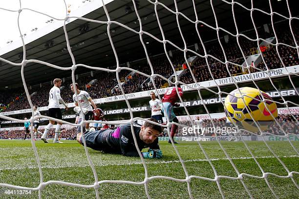 Goalkeeper Hugo Lloris of Spurs looks on as Cheikhou Kouyate of West Ham turns away to celebrate after scoring the opening goal during the Barclays...