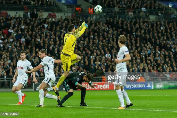 goalkeeper Hugo Lloris of Tottenham Hotspur and Sergio Ramos of Real Madrid battle for the ball during the UEFA Champions League group H match...