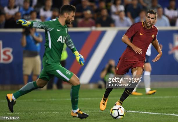 Goalkeeper Hugo Lloris of Tottenham Hotspur tries to kick past Kevin Strootman of AS Roma during their International Champions Cup football match...