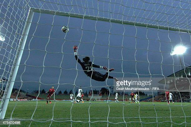 Goalkeeper Ibrahima Sy of Senegal dives to save a shot during the FIFA U20 World Cup New Zealand 2015 Group C match between Portugal and Senegal held...