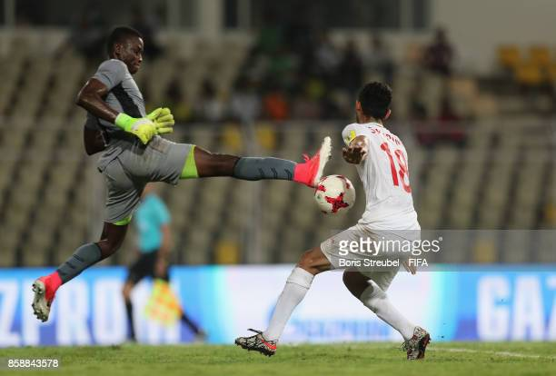 Goalkeeper Ibrahima Sylla of Guinea jumps to save the ball against Saeid Karimi of Iran during the FIFA U17 World Cup India 2017 group C match...
