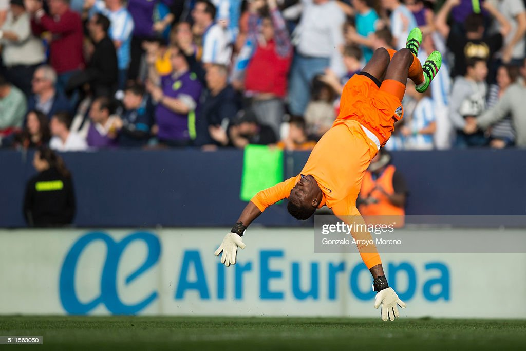 Goalkeeper <a gi-track='captionPersonalityLinkClicked' href=/galleries/search?phrase=Idriss+Carlos+Kameni&family=editorial&specificpeople=689971 ng-click='$event.stopPropagation()'>Idriss Carlos Kameni</a> of Malaga CF celebrates his team's first goal during the La Liga match between Malaga CF and Real Madrid CF at La Rosaleda Stadium on February 21, 2016 in Malaga, Spain.