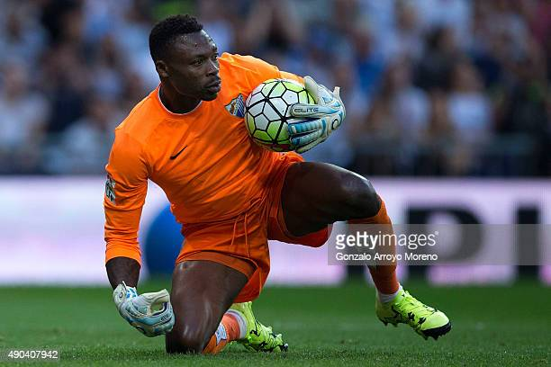 Goalkeeper Idriss Carlos Kameni of Malaga CF holds the ball during the La Liga match between Real Madrid CF and Malaga CF at Estadio Santiago...