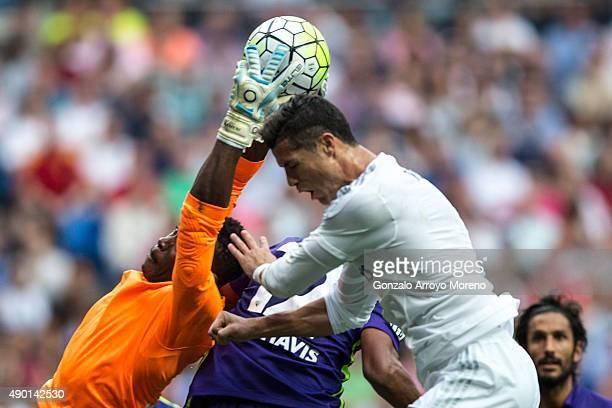 goalkeeper Idriss Carlos Kameni of Malaga CF stops the ball against Cristiano Ronaldo of Real Madrid CF during the La Liga match between Real Madrid...