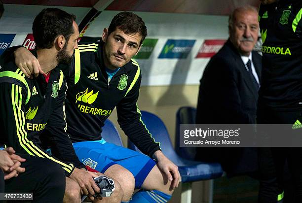 Goalkeeper Iker Casillas embraces his teammate Juan Francisco Torres alias Juanfran sitted on the bench as national coach Vicente del Bosque looks to...