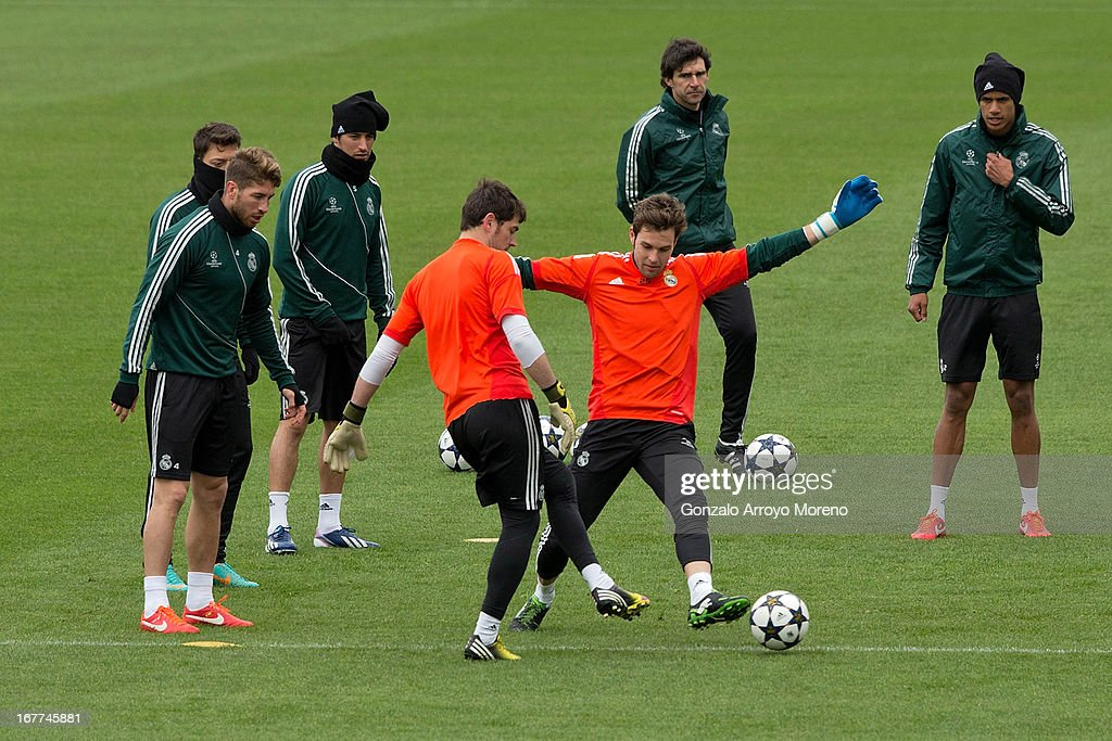 Goalkeeper Iker Casillas excersises with team-mate Jesus Perez during a training session ahead of the UEFA Champions League Semifinal second leg match between Real Madrid and Borussia Dortmund at the Valdebebas training ground on April 29, 2013 in Madrid, Spain.