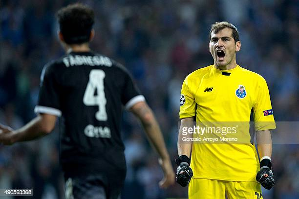 Goalkeeper Iker Casillas of FC Porto celebrates their victory behind Cesc Fabregas of Chelsea FC after the UEFA Champions League Group G match...