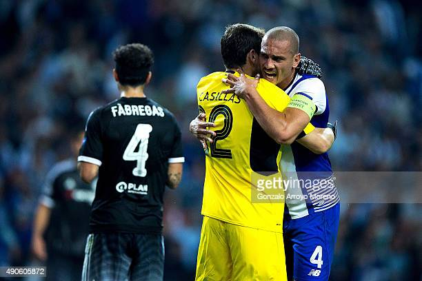 Goalkeeper Iker Casillas of FC Porto celebrates their victory emnracing his teammate Maicon Pereira ahead Cesc Fabregas of Chelsea FC after the UEFA...