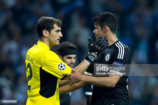Goalkeeper Iker Casillas of FC Porto embraces Diego Costa of Chelsea FC during the UEFA Champions League Group G match between FC Porto and Chelsea...