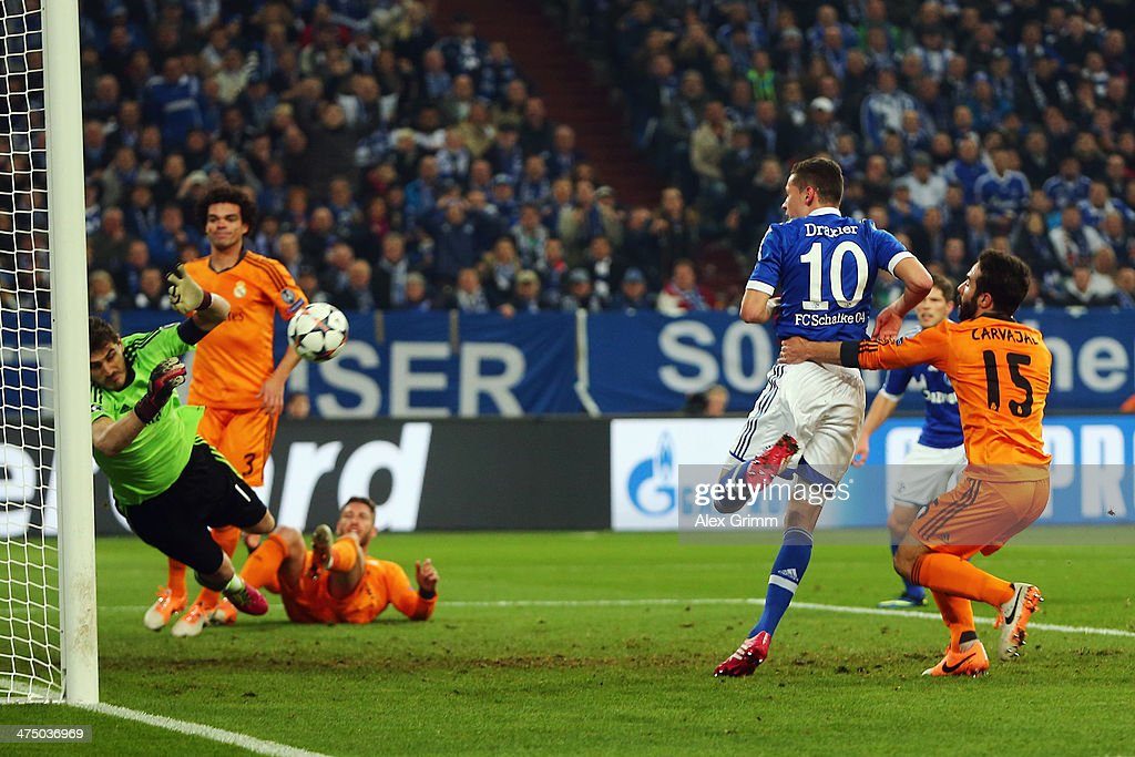 Goalkeeper <a gi-track='captionPersonalityLinkClicked' href=/galleries/search?phrase=Iker+Casillas&family=editorial&specificpeople=215446 ng-click='$event.stopPropagation()'>Iker Casillas</a> of Madrid makes a save against <a gi-track='captionPersonalityLinkClicked' href=/galleries/search?phrase=Julian+Draxler&family=editorial&specificpeople=7184479 ng-click='$event.stopPropagation()'>Julian Draxler</a> of Schalke during the UEFA Champions League Round of 16 first leg match between FC Schalke 04 and Real Madrid at Veltins-Arena on February 26, 2014 in Gelsenkirchen, Germany.