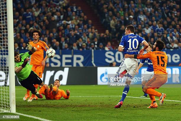 Goalkeeper Iker Casillas of Madrid makes a save against Julian Draxler of Schalke during the UEFA Champions League Round of 16 first leg match...