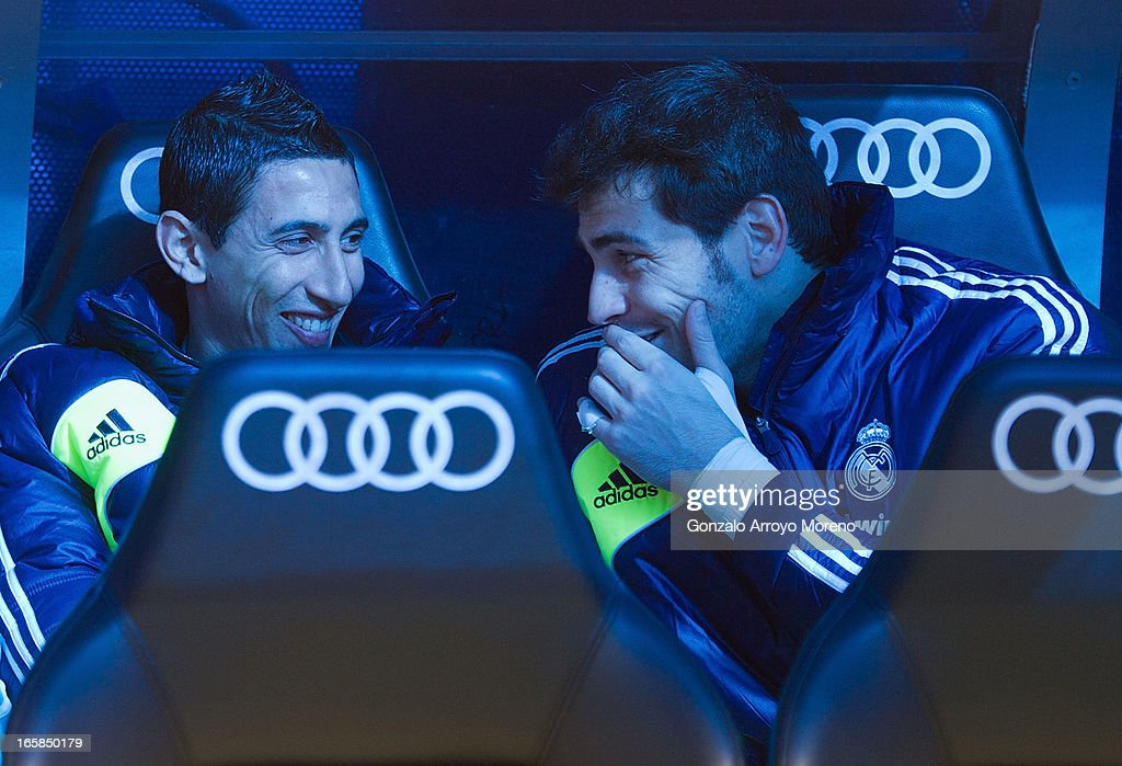 Goalkeeper Iker Casillas (R) of of Real Madrid CF Madrid on the bench with teammate Angel Di Maria (L) prior to tries to start the La Liga match between Real Madrid CF and Levante UD at Santiago Bernabeu Stadium on April 6, 2013 in Madrid, Spain.