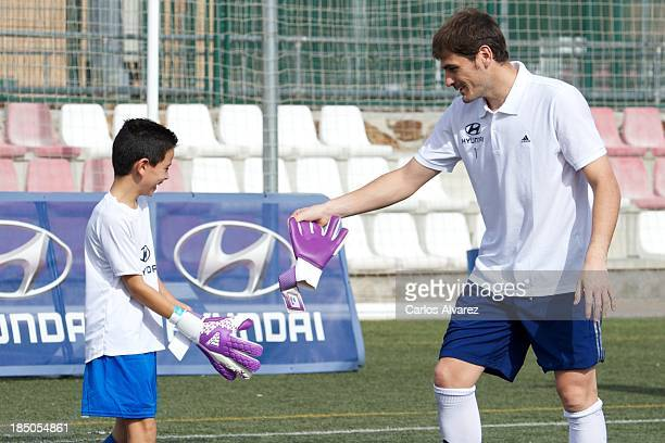 Goalkeeper Iker Casillas of Real Madrid attends an Hyundai Masterclass with children at the Club Deportivo Boadilla del Monte on October 17 2013 in...