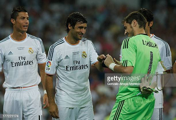 Goalkeeper Iker Casillas of Real Madrid CF gives the captain armband to Raul prior to start the Santiago Bernabeu Trophy match between Real Madrid CF...