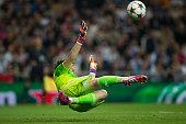 goalkeeper Iker Casillas of Real Madrid CF looses the ball scored by KlaasJan Huntelaar of FC Schalke 04 during the UEFA Champions League round of 16...