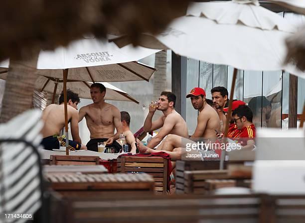 Goalkeeper Iker Casillas of Spain enjoys a drink amid his teammates Javi Martinez Ignacio Monrea Santiago Cazorla Jesus Navas and David Villa at the...