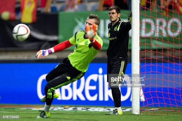 Goalkeeper Iker Casillas of Spain looks to his teammate goalkeeper David de Gea during their warming up prior to start the international friendly...