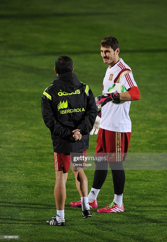Goalkeeper Iker Casillas of Spain speaks to an assistant coach during a training session ahead of their international friendly against Equatorial Guinea on November 13, 2013 in Las Rozas, Spain.