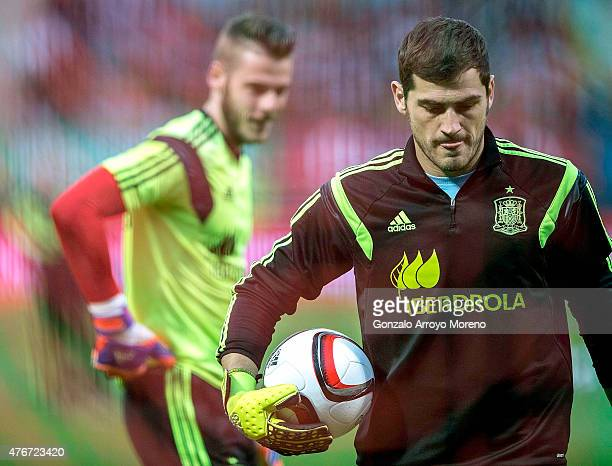 Goalkeeper Iker Casillas of Spain walks on ahead his teammate goalkeeper David de Gea during their warming up prior to start the international...