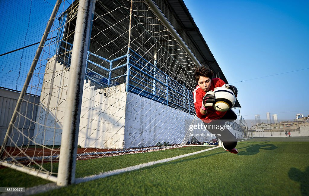 Goalkeeper is seen during the women's training of Atasehir Belediyespor soccer team in Istanbul, Turkey on April 9, 2014. Players of Atasehir Belediyespor in Turkish Women's First Football League, women players play soccer at the same time they continue their education. Women players of soccer team indulging their passion for soccer requires more than just talent and training.