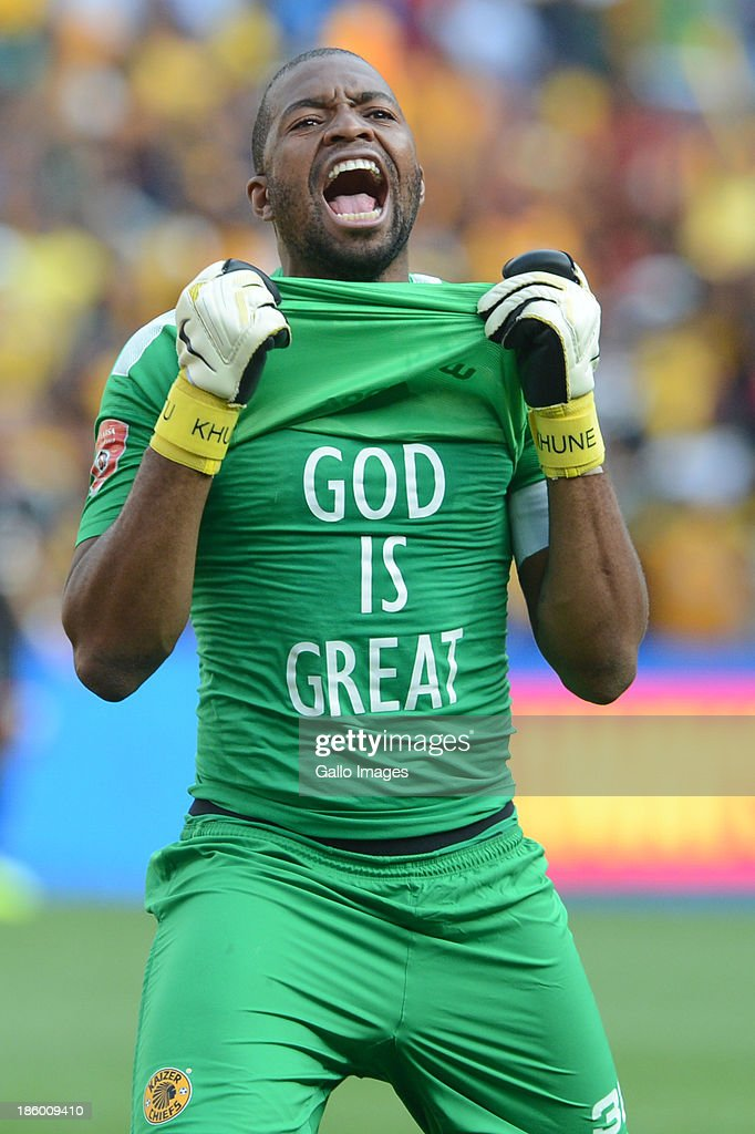 Goal-keeper Itumeleng Khune celebrates during the Absa Premiership match between Orlando Pirates and Kaizer Chiefs at FNB Stadium on October 26, 2013 in Soweto, South Africa.