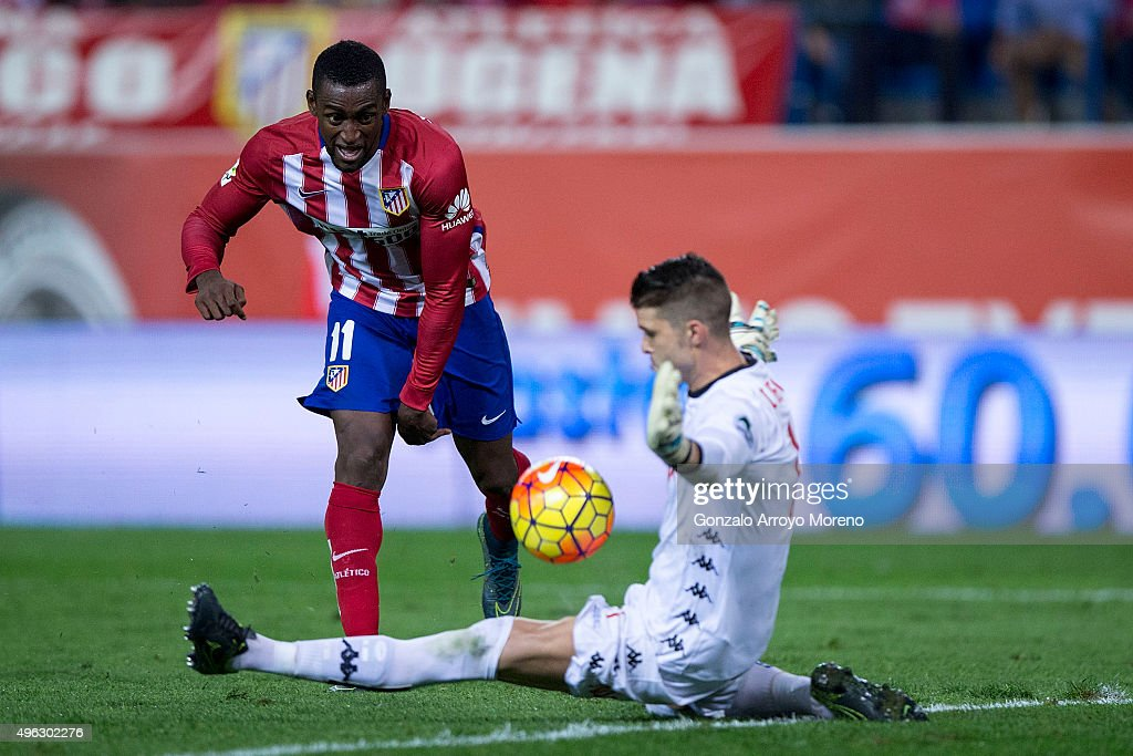 goalkeeper Ivan Cuellar (R) of Real Sporting de Gijon stops the ball striked by Jackson Arley Martinez (L) of Atletico de Madrid during the La Liga mathc bewteen Club Atletico de Madrid and Real Sporting de Gijon at Vicente Calderon Stadium on November 8, 2015 in Madrid, Spain.