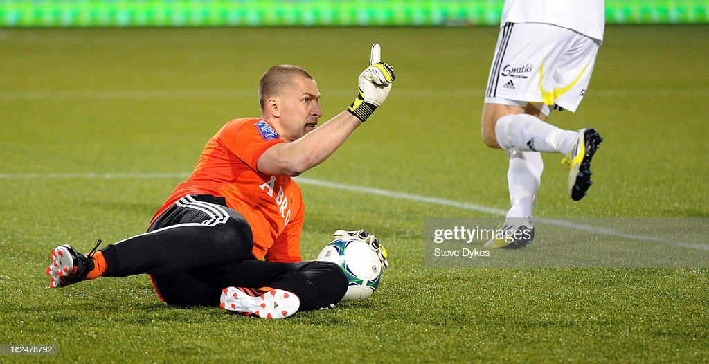 Goalkeeper Ivan Turina #27 of AIK makes a stop during the second half of the game against the Portland Timbers at Jeld-Wen Field on February 23, 2013 in Portland, Oregon. The game ended in a 1-1 draw.