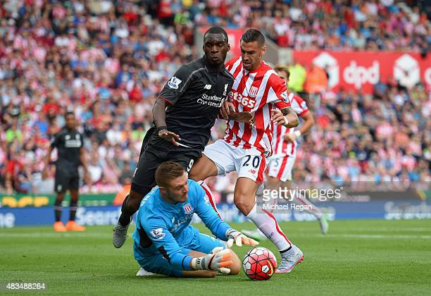 Goalkeeper Jack Butland and Geoff Cameron of Stoke City foil Christian Benteke of Liverpool during the Barclays Premier League match between Stoke...