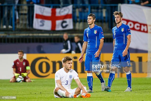 Goalkeeper Jack Butland and Luke Garbutt of England and Lorenzo Crisetig and Daniele Rugani of Italy look disappointed after the UEFA Under21...