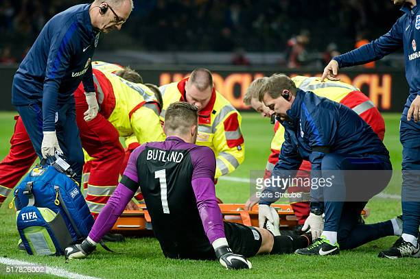 Goalkeeper Jack Butland of England sits on the pitch after injury during the International Friendly match between Germany and England at...