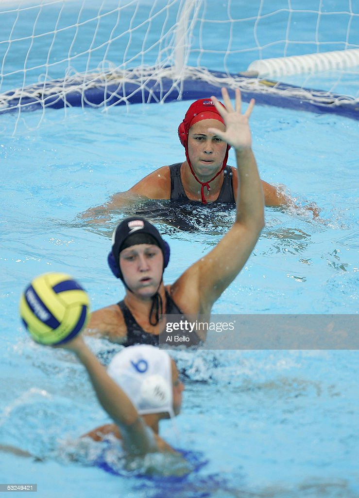 Goalkeeper Jaime Hipp and Lauren Wenger of the US watch on defense as Jennifer Pareja of Spain creates a play in the preliminary match during the XI...