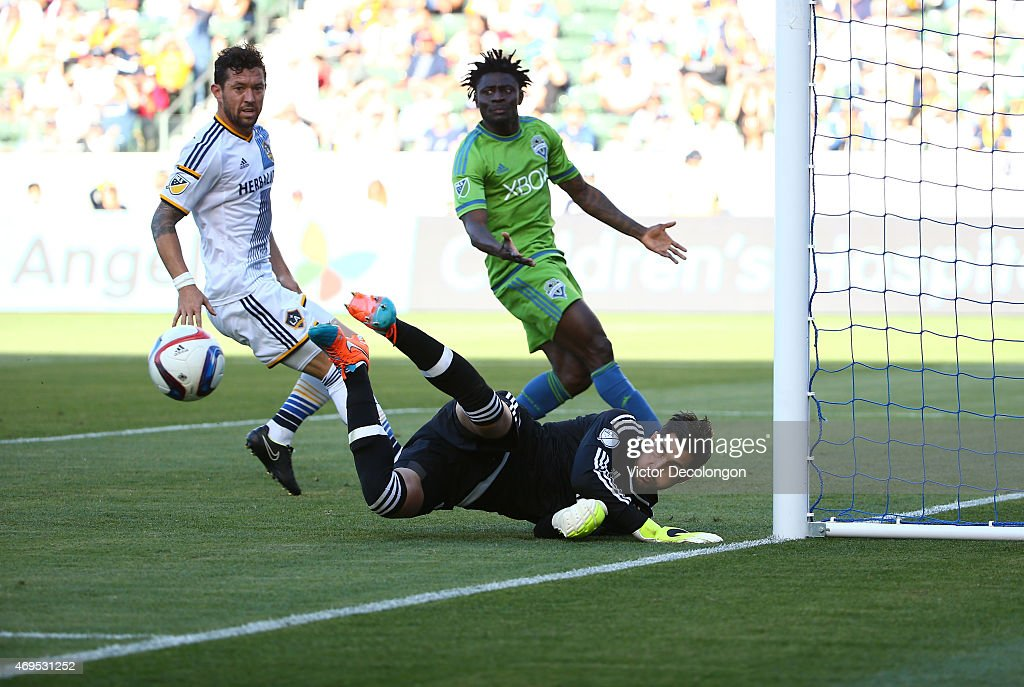 Goalkeeper Jaime Penedo #18 of Los Angeles Galaxy makes a save as teammate Dan Gargan #33 marks <a gi-track='captionPersonalityLinkClicked' href=/galleries/search?phrase=Obafemi+Martins&family=editorial&specificpeople=224574 ng-click='$event.stopPropagation()'>Obafemi Martins</a> #9 of Seattle Sounders FC in the second half of the MLS match at StubHub Center on April 12, 2015 in Los Angeles, California. The Galaxy defeated the Sounders 1-0.