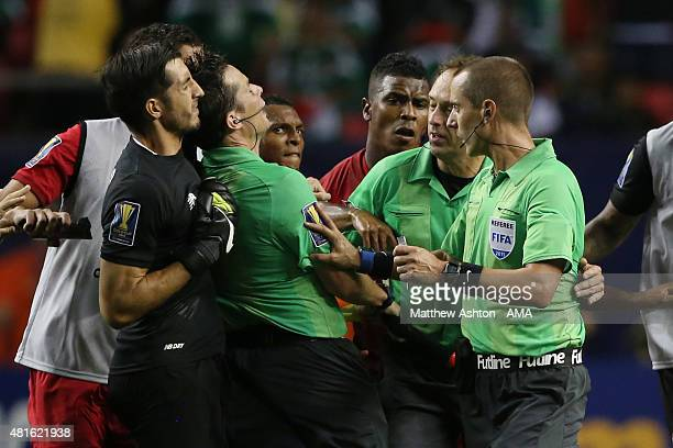 Goalkeeper Jaime Penedo of Panama confronts Referee Mark Geiger at the end of the 2015 CONCACAF Gold Cup Semi Final between Panama and Mexico at...