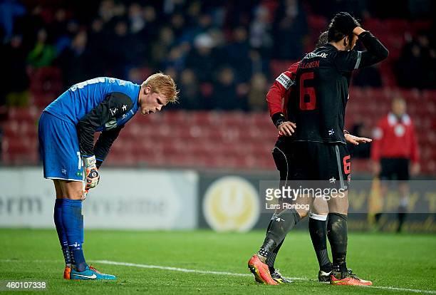 Goalkeeper Jakob Haugaard of FC Midtjylland and Jim Larsen of FC Midtjylland looks dejected during the Danish Superliga match between FC Copenhagen...