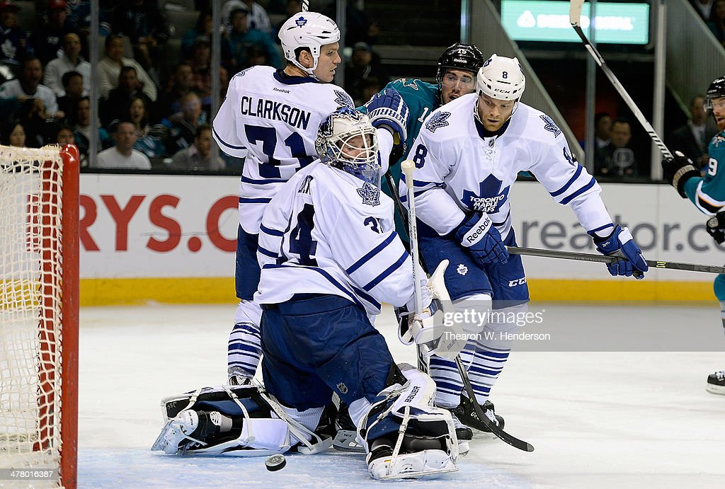 Goalkeeper James Reimer #34 and <a gi-track='captionPersonalityLinkClicked' href=/galleries/search?phrase=Tim+Gleason&family=editorial&specificpeople=211575 ng-click='$event.stopPropagation()'>Tim Gleason</a> #8 of the Toronto Maple Leafs watches the puck come out of the net after a goal by Tommy Wingles (not pictured) of the San Jose Sharks during the second period at SAP Center on March 11, 2014 in San Jose, California.