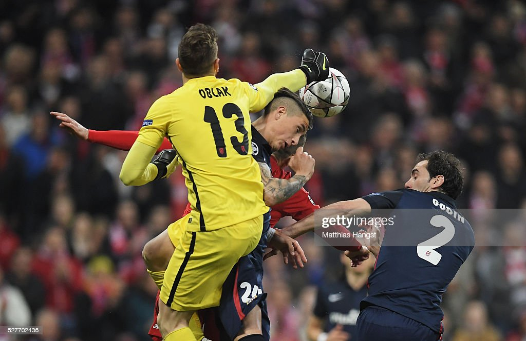 Goalkeeper <a gi-track='captionPersonalityLinkClicked' href=/galleries/search?phrase=Jan+Oblak&family=editorial&specificpeople=8900856 ng-click='$event.stopPropagation()'>Jan Oblak</a> and Jose Gimenez of Atletico Madrid (24) clear their penalty area during UEFA Champions League semi final second leg match between FC Bayern Muenchen and Club Atletico de Madrid at Allianz Arena on May 3, 2016 in Munich, Germany.