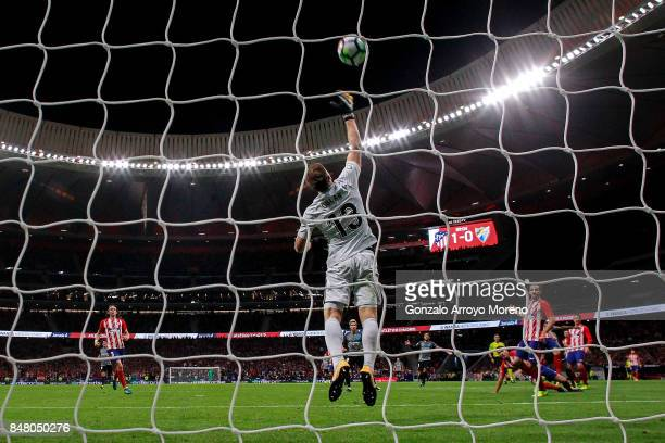 Goalkeeper Jan Oblak blocks the ball during the La Liga match between Club Atletico Madrid and Malaga CF at Estadio Wanda Metropolitano on September...