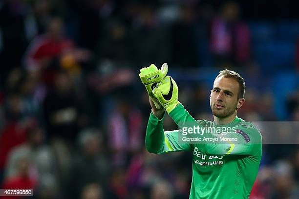 Goalkeeper Jan Oblak of Atletico de Madrid claps to the audience after winning the UEFA Champions League round of 16 second leg match between Club...