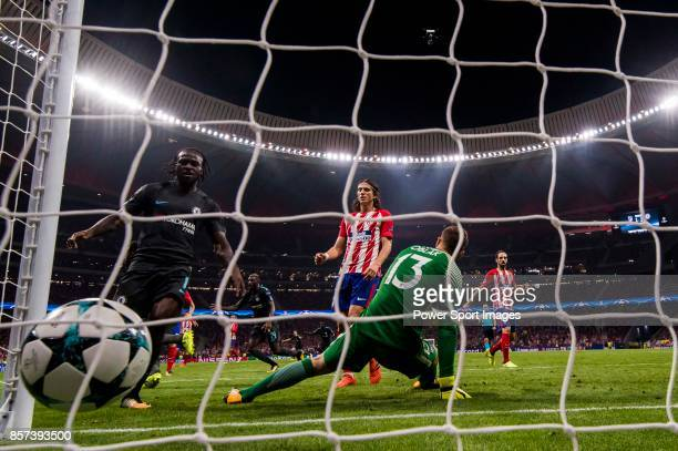 Goalkeeper Jan Oblak of Atletico de Madrid fails to save the shot by Michy Batshuayi of Chelsea FC during the UEFA Champions League 201718 match...